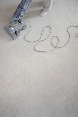 Man Vacuuming the Carpet